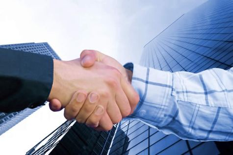 shaking hands on deal, skyscraper background